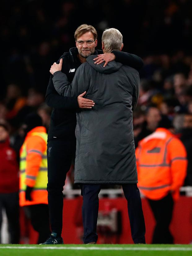 Liverpool boss Jurgen Klopp and Arsenal manager Arsene Wenger embrace at the end of the game. Pic: PA