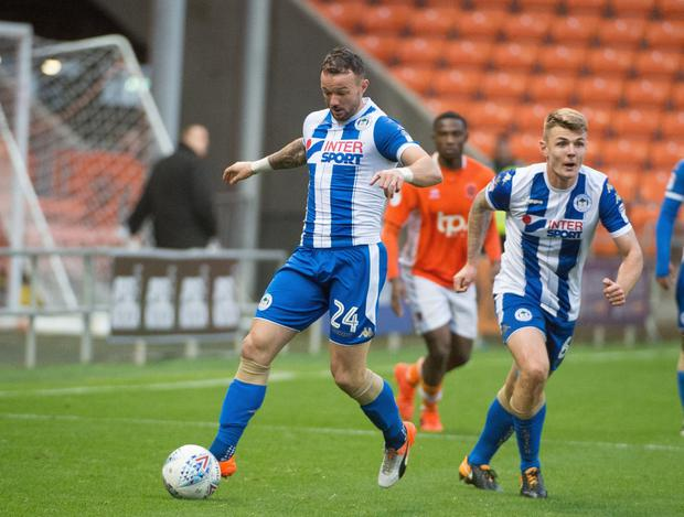 Irish striker Noel Hunt (l) in action for Wigan Athletic during a recent League One clash with Blackpool. Pic courtesy of Bernard Platt/Wigan Post