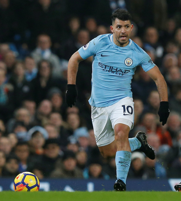 Aguero struck twice as City moved 13 points clear at the summit on Saturday with a 4-0 thrashing of Bournemouth. Photo: Reuters