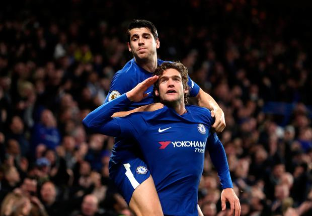 Chelsea's Marcos Alonso celebrates scoring his side's second goal with Alvaro Morata (top) during yesterday's Premier League encounter at Stamford Bridge. Pic: Adam Davy/PA