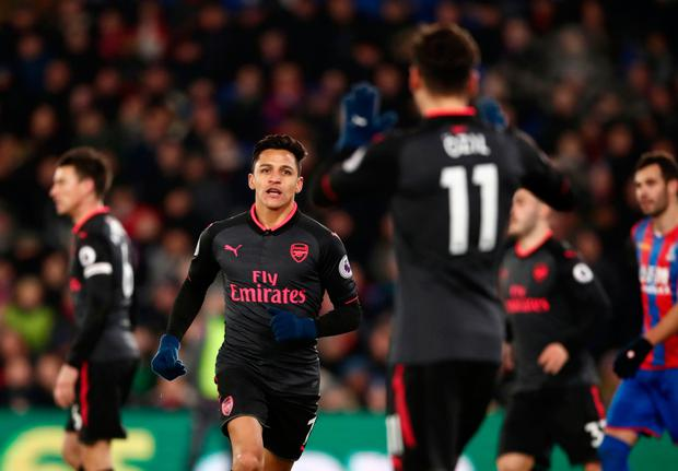 Arsenal's Alexis Sanchez celebrates the first of his two goals in the Premier League win at Crystal Palace last nigh Photo: PA