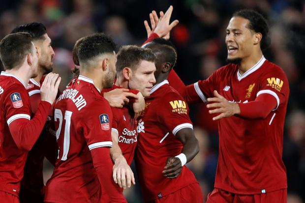James Milner celebrates after giving Liverpool the lead from the penalty spot in last night's FA Cup third round win over Everton at Anfield.