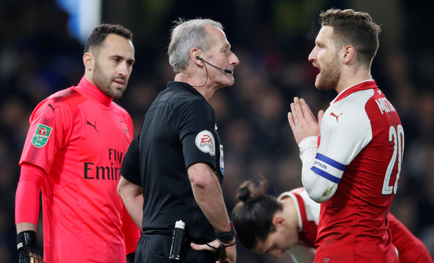 Arsenal players remonstrate with ref Martin Atkinson last night