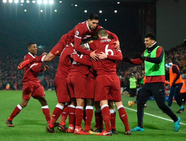 The Liverpool players celebrate after Sadio Mane put away their third goal of the match