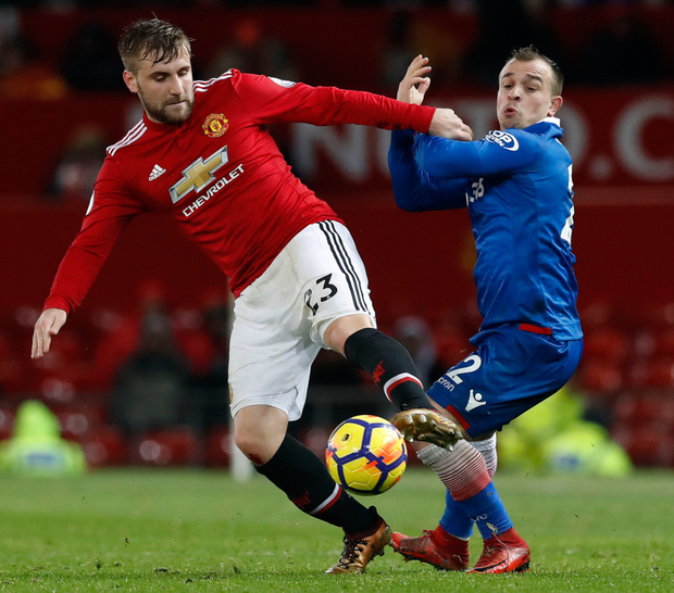 Manchester United's Luke Shaw and Stoke City's Xherdan Shaqiri (right) during the Premier League match at Old Trafford