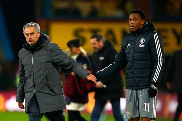 Manchester United boss Jose Mourinho and Anthony Martial. Photo: PA