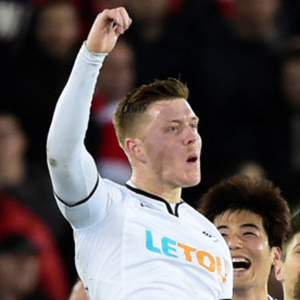 Alfie Mawson celebrates his goal for Swansea in last night's Premier League win over Liverpool at the Liberty Stadium