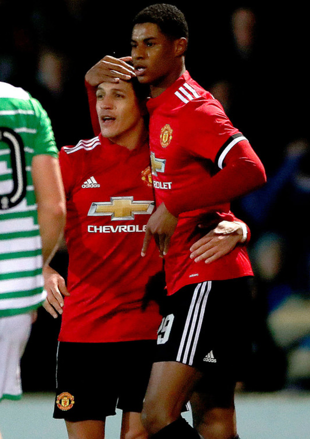 Manchester United striker Marcus Rashford celebrates with his new team-mate Alexis Sanchez after opening the scoring in last night's FA Cup fourth round win at Yeovil