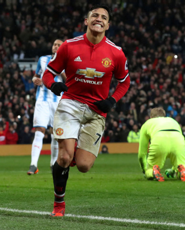 Manchester United's Alexis Sanchez celebrates his first goal for the club in Saturday's win over Huddersfield Photo: Reuters