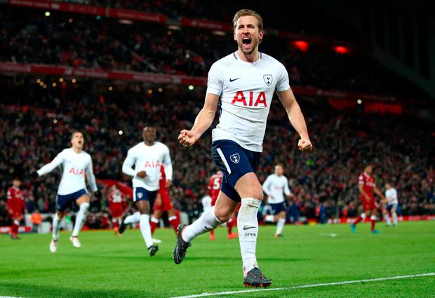 Spurs' Harry Kane celebrates after scoring a late penalty at Anfield yesterday - his 100th Premier League goal. Photo: Getty