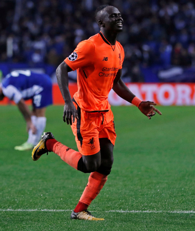 Sadio Mane celebrates scoring Liverpool's fifth goal and completing his hat trick against Porto on Wednesday night