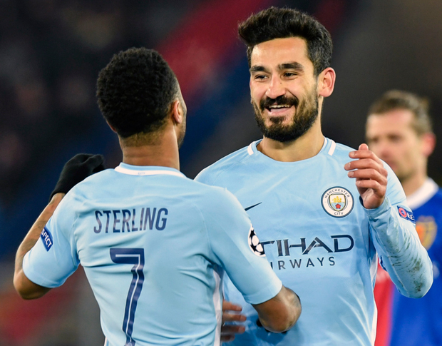 Manchester City's Ilkay Gundogan (right) celebrates scoring his second goal with Raheem Sterling as City beat Basel 4-0 in the Champions League on Tuesday night