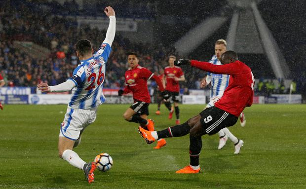 ROM' RAID: Romelu Lukaku opens the scoring for Manchester United in the FA Cup fifth round win at Huddersfield on Saturday