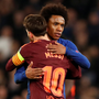 Honours even: Chelsea goalscorer Willian embraces Barcelona's marksman Lionel Messi after Tuesday night's Champions League last-16 first leg clash