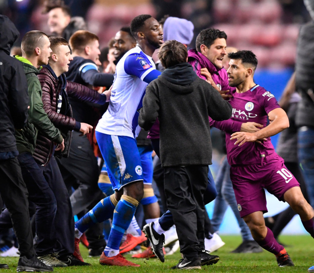 Trouble: Sergio Aguero confronts Wigan fans after Monday night's FA Cup defeat at the DW Stadium