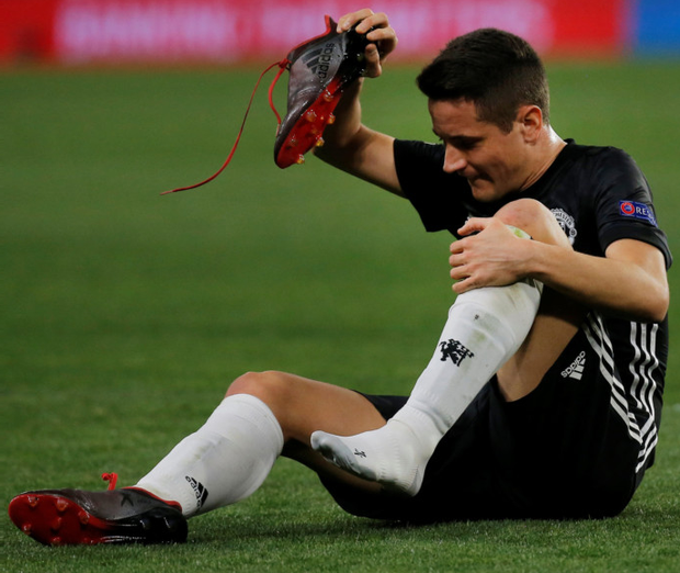 Injury hell: Ander Herrera shows his frustration after sustaining an injury against Sevilla last Wednesday night