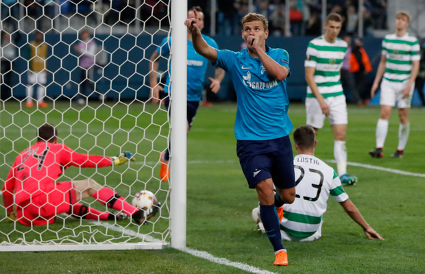Three and out: Zenit's Aleksandr Kokorin celebrates scoring his side's third goal during the Europa League round of 32 second leg clash with Celtic at the St Petersburg stadium, in St Petersburg, Russia, yesterday