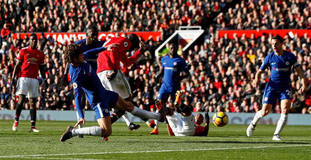LEVELLER: Romelu Lukaku scores Manchester United's equaliser against Chelsea at Old Trafford yesterday