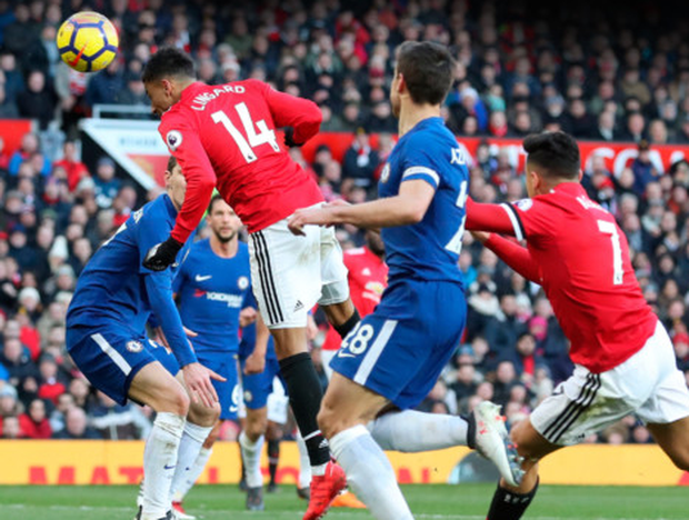 HEADS I WIN: Jesse Lingard heads home Manchester United's winner against Chelsea yesterday