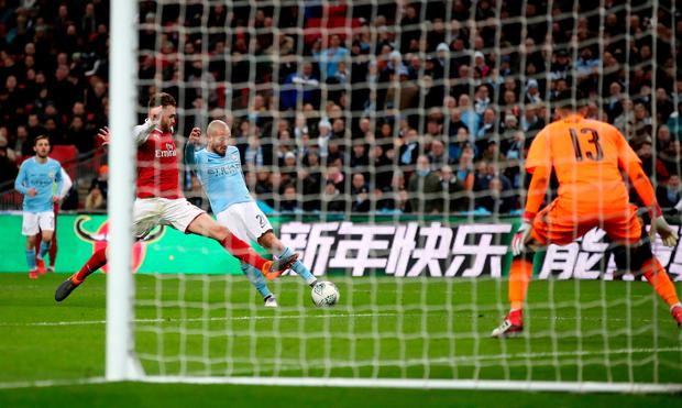 David Silva fires home City's third in the League Cup final rout of Arsenal