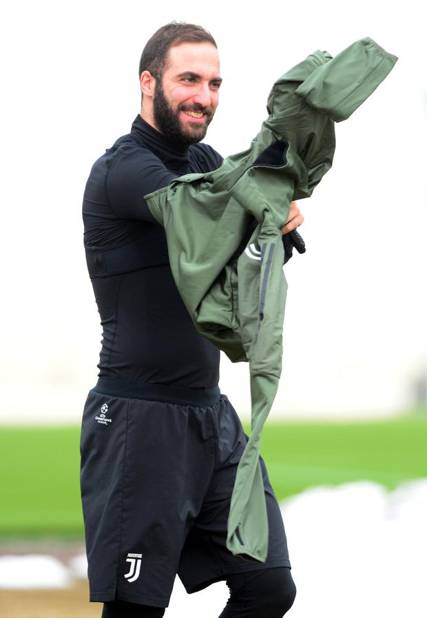 Italian job: Juventus' Gonzalo Higuain is pictured during training yesterday