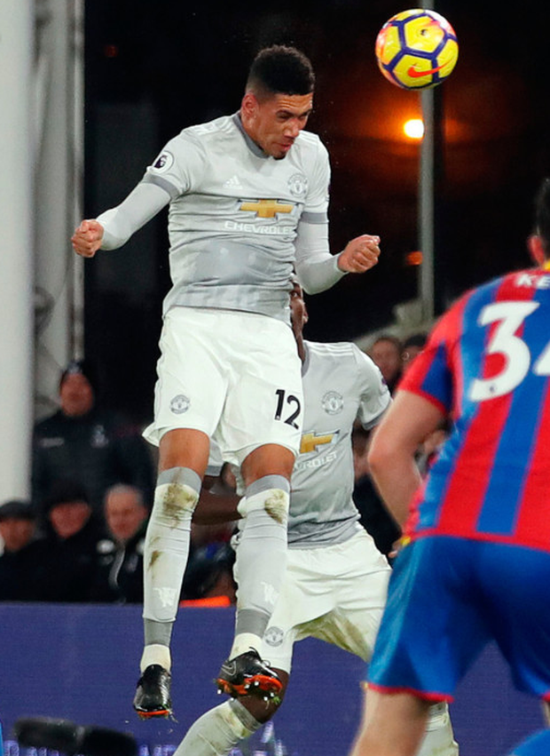 Strike: Chris Smalling heads home against Palace