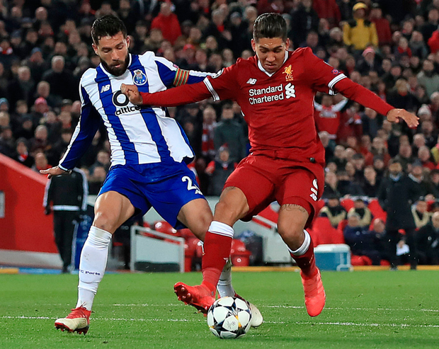 In control: Porto's Felipe Augusto de Almeida Monteiro (left) and Liverpool's Roberto Firmino battle for the ball at Anfield last night. Photo: PA