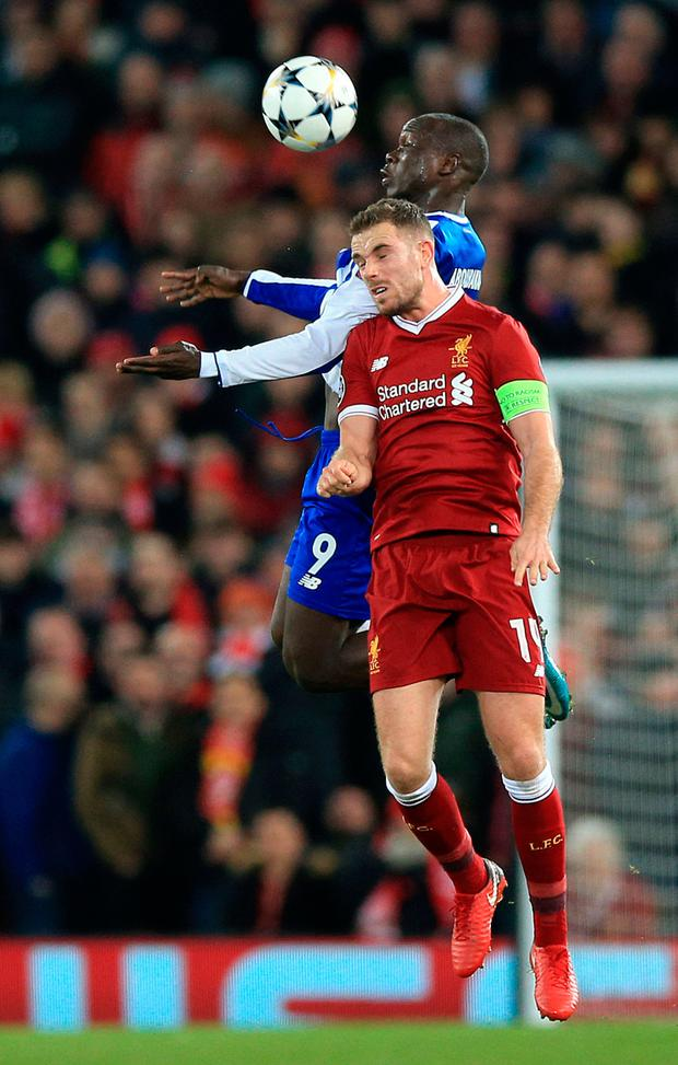Heads up: Liverpool's Jordan Henderson and Porto's Vincent Aboubakar battle for the ball during the Champions League last-16 second leg clash at Anfield. Photo: PA