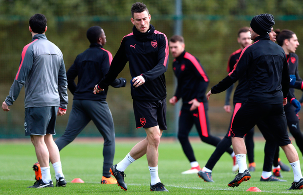 Misfiring Gunners: Arsenal players, including Laurent Koscielny (c), train ahead of this evening's Europa League clash with AC Milan