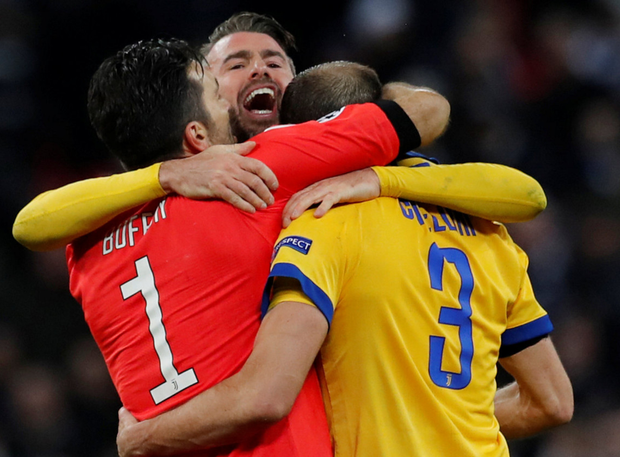 Juventus' Gianluigi Buffon, Andrea Bargaghli and Georgio Chiellini celebrate