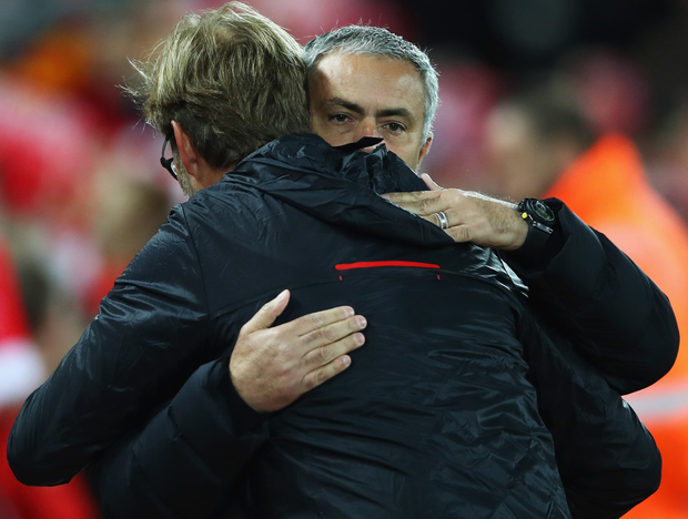 Red rivals: Manchester United manager Jose Mourinho embraces his Liverpool rival last season as the duo prepare to face each other again at Old Trafford today