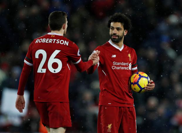 Mohamed Salah celebrates his hat-trick with Andy Robertson in Saturday's win over Watford