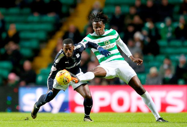 TUSSLE: Celtic's Dedryck Boyata (right) and Dundee's Roarie Deacon battle for the ball during the Scottish Premiership match at Celtic Park last night Photo: PA