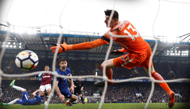 HAMMERED HOME: West Ham striker Javier Hernandez fires in his side's equalising goal against Chelsea yesterday, much to the horror of Blues boss Antonio Conte Photo: Reuters