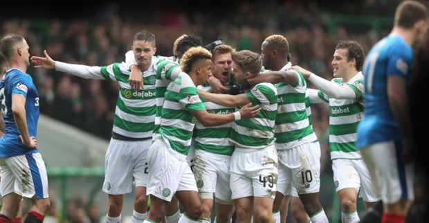 Firm foes: Celtic players celebrate in their Scottish Premiership win over Rangers at Celtic Park last year