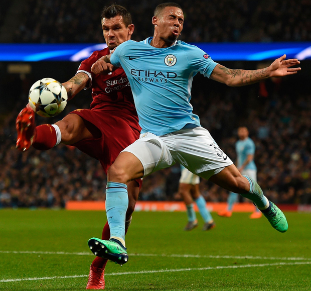 Up and away: Dejan Lovren clears the ball from Manchester City striker Gabriel Jesus