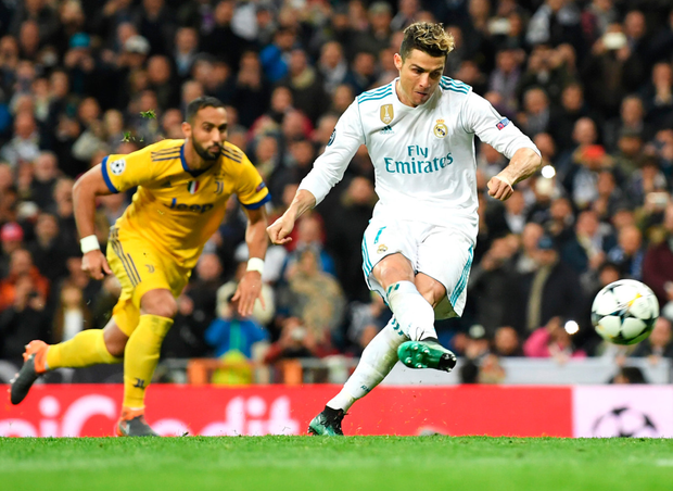 Spot on: Real Madrid's Cristiano Ronaldo scores from an injury-time penalty to break Juve hearts and put his side through to the Champions League semi-final