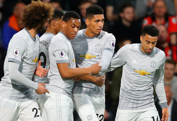 Small mercies: Chris Smalling (second right) is congratulated by his team-mates after scoring against Bournemouth