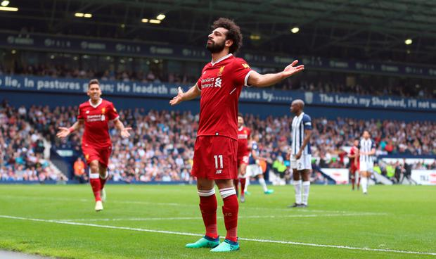 GOAL STANDARD: Liverpool forward Mohamed Salah celebrates opening the scoring in the 2-2 draw at West Brom on Saturday. Photo: PA