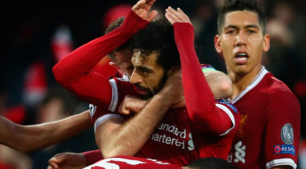 Mohamed Salah celebrates his opener for Liverpool with team-mates in last night's win