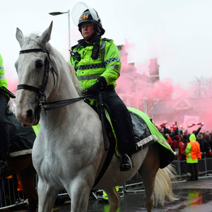 Patrol: The scene outside Anfield before Tuesday evening's clash between Liverpool and Roma