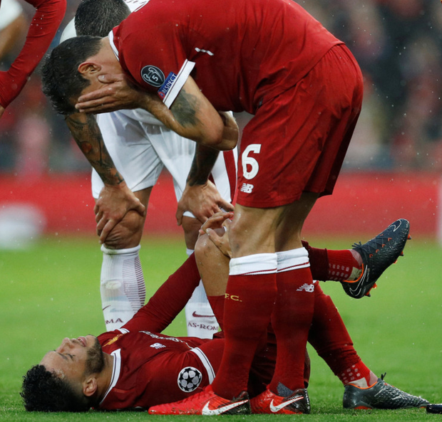 Agony: Alex Oxlade-Chamberlain lies stricken on the Anfield turf after sustaining a knee injury in Tuesday night's Champions League semi-final first leg win over Roma