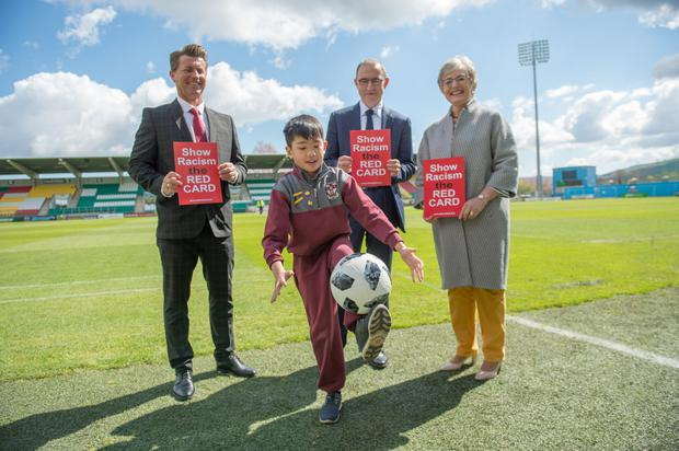 LOOKING ON: At the Show Racism the Red Card awards ceremony at Tallaght Stadium were (l-r) Colin Bell, manager of the Republic of Ireland women's team, Martin O'Neill, manager of the Ireland men's team and Minister for Children and Youth Affairs Katherine Zappone TD watching Kevin Nguyen from St Aidan's School in Dublin display his soccer skills. Photo: Barry Cronin