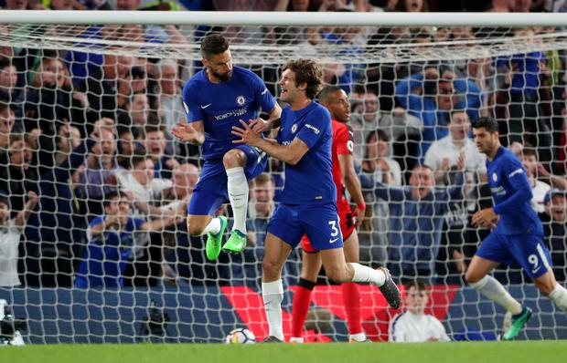 Chelsea's Marcos Alonso (right) celebrates his equalising goal with team-mate Olivier Giroud.