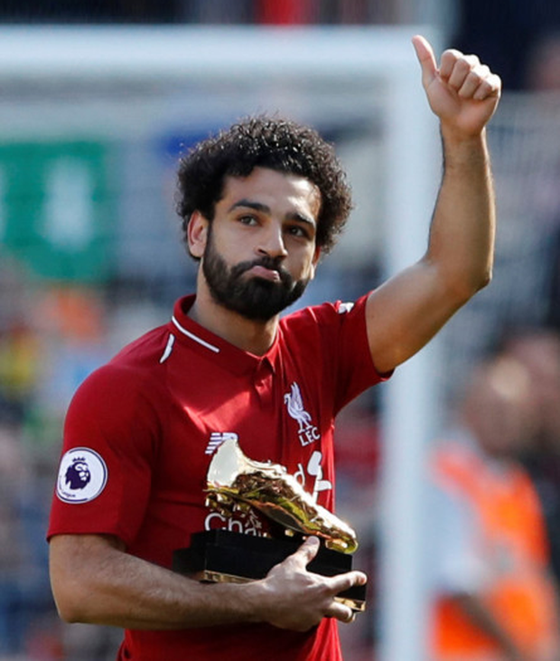 Golden boy: Liverpool forward Mohamed Salah is pictured with the Golden Boot after finishing the Premier League as top scorer
