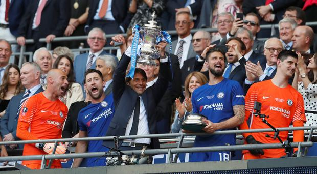 Chelsea manager Antonio Conte lifts the FA Cup after his side beat Manchester United at Wembley on Saturday