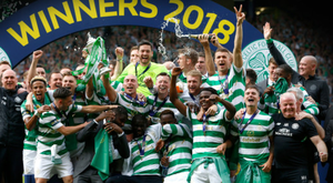 The Celtic squad, management and backroom staff celebrate their Scottish Cup final win over Motherwell at Hampden Park on Saturday