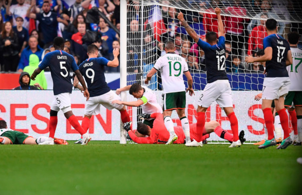 FIRST: France striker Olivier Giroud (second from left) pokes home to score the first goal in last night's friendly win over Ireland at the Stade de France in Paris. Photo: Sportsfile