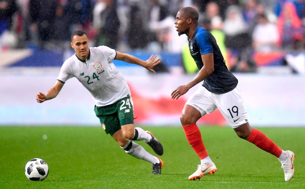 CLOSE CALL: (l-r) Ireland substitute Graham Burke tracks France's Djibril Sidibe in last night's friendly clash in Paris. Photo: Sportsfile