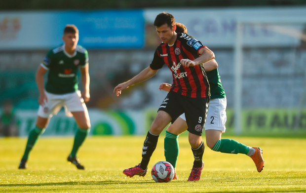 TUSSLE: Bohemians' Dinny Corcoran in action against Conor McDermott of Derry City during the SSE Airtricity League Premier Division match at Dalymount Park last night. Pic: Sportsfile